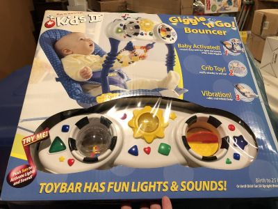 New in box versatile Giggle and Go Bouncer