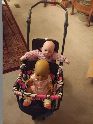 2 beautiful baby dolls in a double stroller