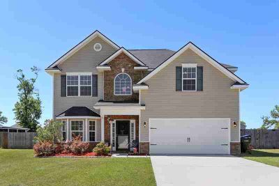 537 Mustang Lane NE LUDOWICI Four BR, From the moment you walk