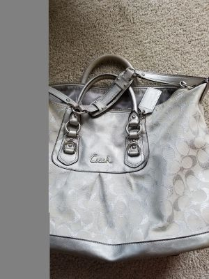 Coach purse. Silver. Shoulder strap has some wear and needs cleaned