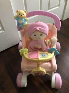 BAbys 1st doll and stroller