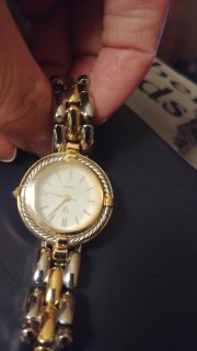 NEW WATCH WIRKS FINE NEEDS BATTERY GOLD AND SILVER FROM NORSTRUM PAID $69