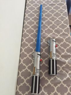 2 retractable light sabers