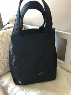 Nike bag with zippered pouch and a place for a water bottle . Perfect for baby, gym or pool