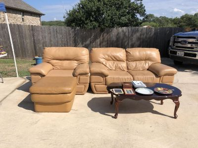 Leather love seat, chair, ottoman, and coffee table