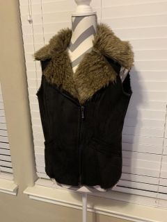 NEW!! Women s large vest. New!! Super warm and furry. Angleton pick up.