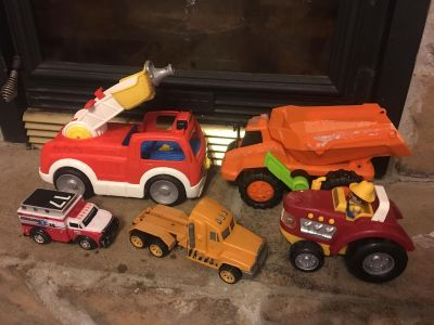 Assortment of 5 toy trucks/tractor. $7 for all