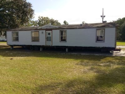 Selling a 2Ac lot with a double wide mobile home