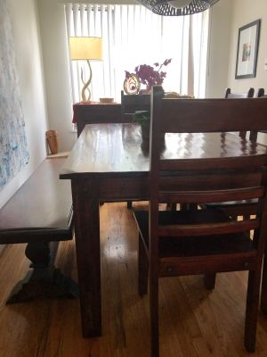 Reclaimed wood dining table + chairs and bench