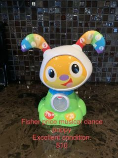 Fisher price dancing puppy