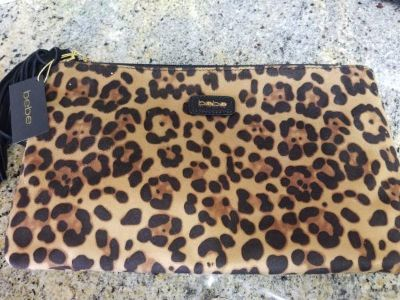 Brand new Bebe zippered clutch bag