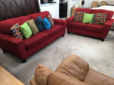 2pc Upholstered Red Sofa Set with Throw pillows.