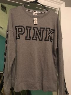 Victoria Secret gray and black pull over. Size Medium. Brand new with tags! Reg $50