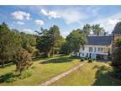 Inn for Sale: High Meadows Vineyard Inn & Carriage House