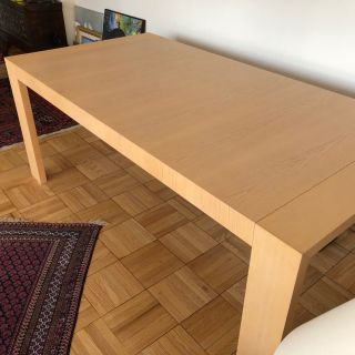 Dining table . Wood , seats 6 to 8