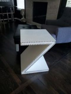 White faux leather end table w/silver nail heads