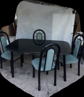 Table with 4 sturdy chairs. SERIOUS BUYERS PLEASE.
