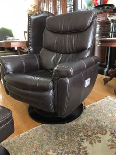 Genuine swivel recliner with foot rest