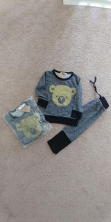 NWT gender neutral sweater and pant set
