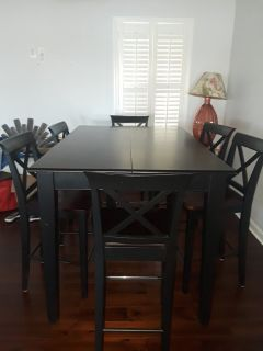 Dining room table with 8chairs and a leaf