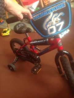 Classic Red toddler bike with training wheels