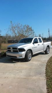 $27,000, 2012 Dodge Ram 4x4 Quad Cab with 15,000 miles
