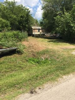 Almost 1- acre lot with mobile home in Crosby