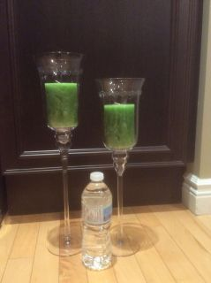 Two antique glass candle holders