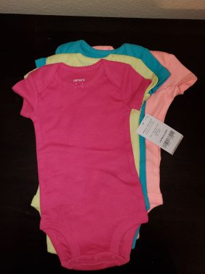 Set of 4 Carters newborn onesies NEW