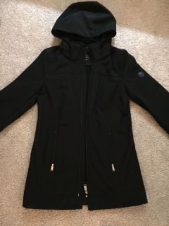 Andrew Marc black jacket. Water repellent, 4-way stretch and detachable hood. Worn only a few times!!