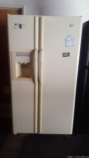 Side by side refrigerator freezer about 15 years old. Works fine.