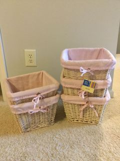 White wicker baskets w/ pink gingham liners
