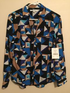Ladies blouse. New with tags $10