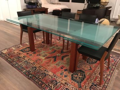 Modern glass dining room table, wood base