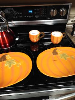 brand new never used Two adorable pumpkin platters / plates with two matching cups/ holders