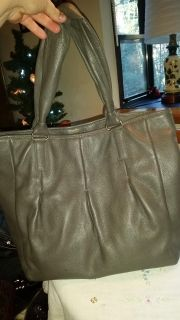 Gray leather Cole Haan purse.
