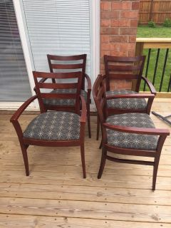 Four wood dining chairs