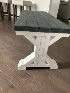 A Farm Style Bench and Two Chairs