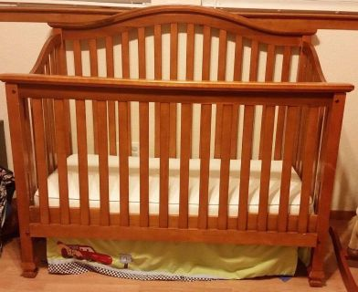 Convertible crib/toddler bed/headboard with new mattress