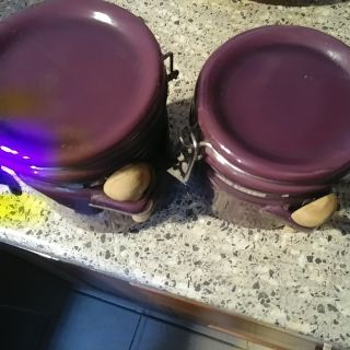 2 purple cannisters with spoons, never used, dont drink coffee and barely drink tea at home and use sugar packets not bag