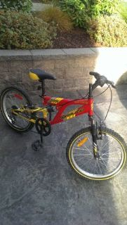 yellow and red child sized mountain bike