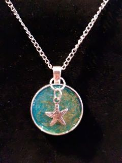 Resin Pendant with starfish charm.