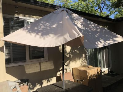 Patio table and four chairs w/ umbrella
