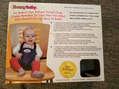 Snazzy Baby travel chair. Brand new in box. Great for traveling