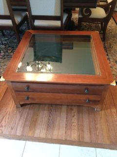 Great wood coffee table with tons of storage