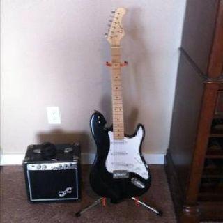 $210 California series eletric guitar w/guitar stand and eletric guitar amp