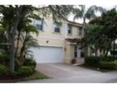 Spacious single family home(3/2.5) with a pool and lake view