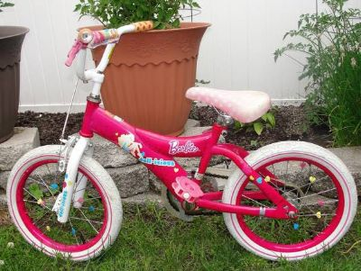 "Barbie .. Pink .. Doll-icious .. 16"" Girls Bike with helmet .. pre-owned with normal wear"