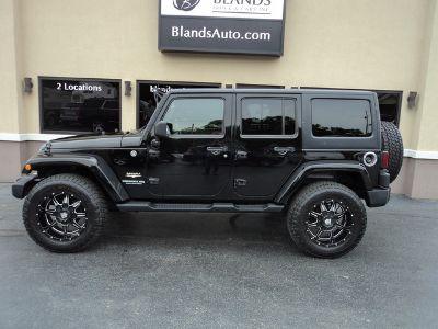 2012 Jeep Wrangler Unlimited Sahara (Black Clearcoat)