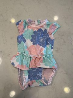 Ruffle butts brand bathing suit, size 12-18 months.